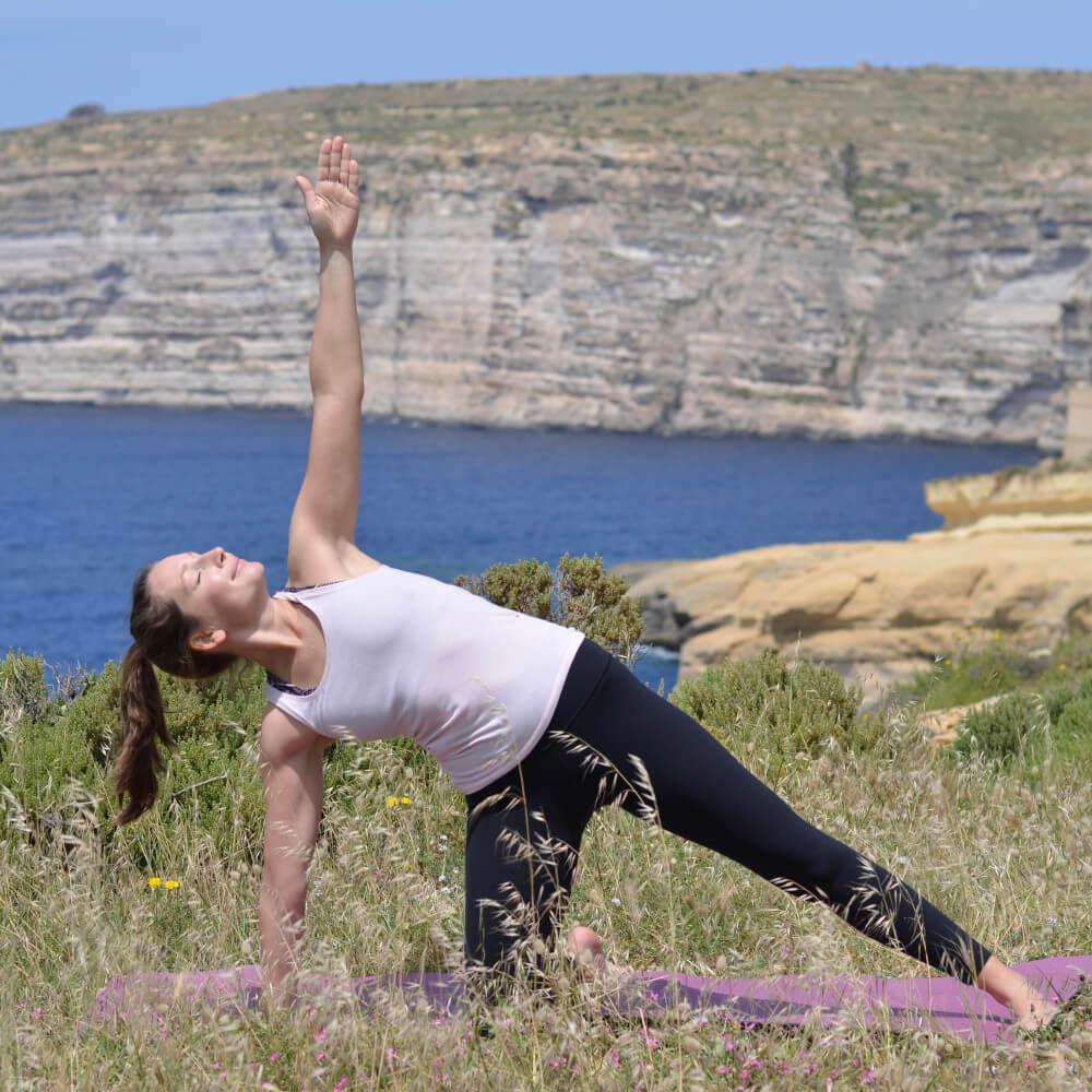 yoga on cliffs in xlendi gozo